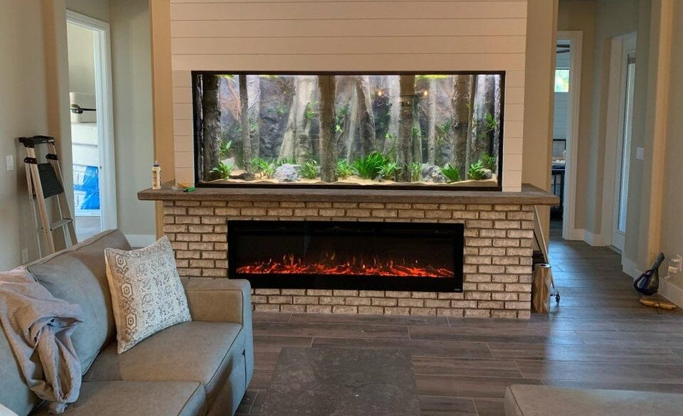 fish tank next to fireplace